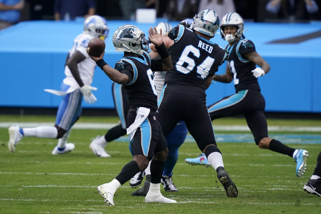 Carolina Panthers quarterback P.J. Walker throws his first NFL touchdown past during the second half of an NFL football game against the Detroit Lions...