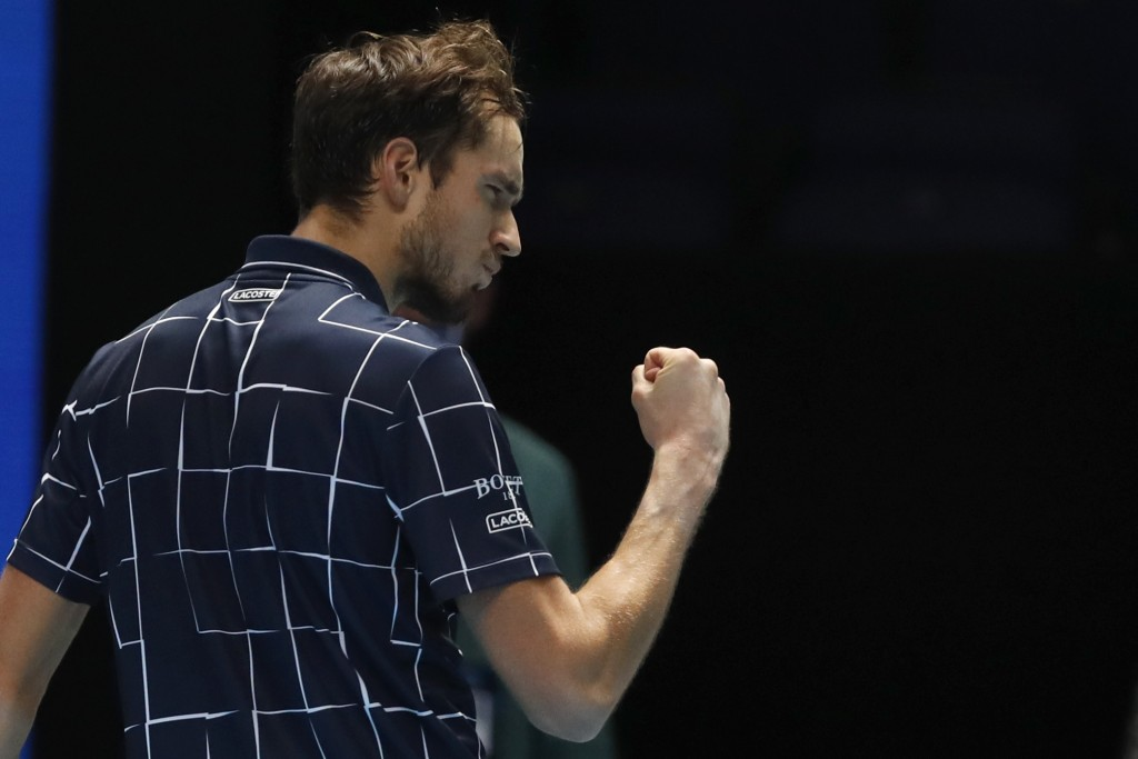 Daniil Medvedev of Russia gestures to a television camera after he wins match point against Dominic Thiem of Austria during their singles final tennis...