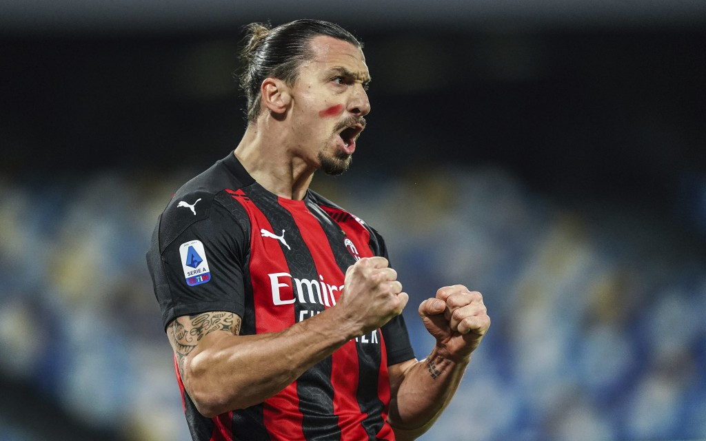 AC Milan's Zlatan Ibrahimovic celebrates scoring during the Serie A soccer match between Napoli and AC Milan, at the San Paolo Stadium in Naples, Ital...