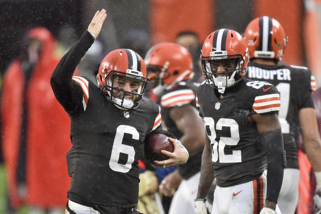 Cleveland Browns quarterback Baker Mayfield (6) signals a first down during the second half of an NFL football game against the Philadelphia Eagles, S...
