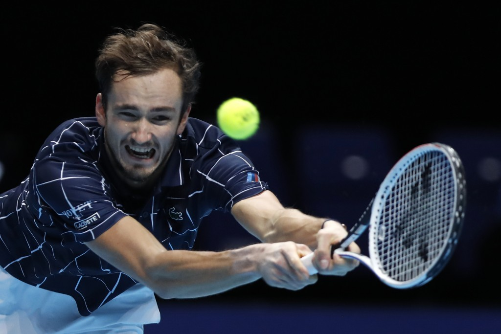 Daniil Medvedev of Russia plays a return to Dominic Thiem of Austria during their singles final tennis match at the ATP World Finals tennis tournament...