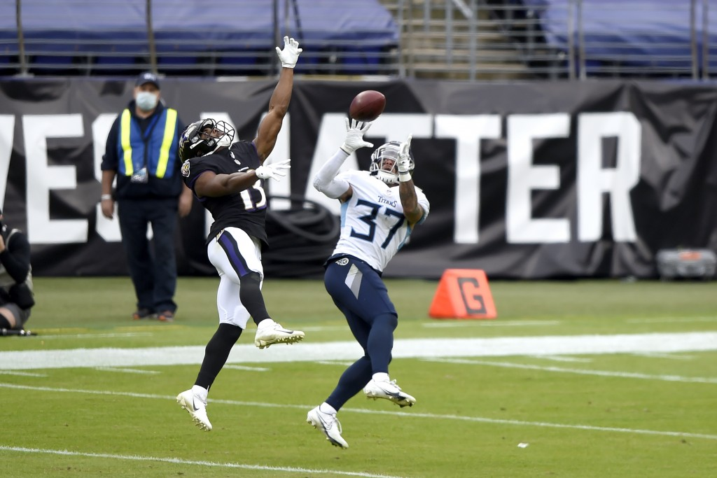 Tennessee Titans safety Amani Hooker (37) prepares to intercept a pass from Baltimore Ravens quarterback Lamar Jackson, not visible, intended for wide...