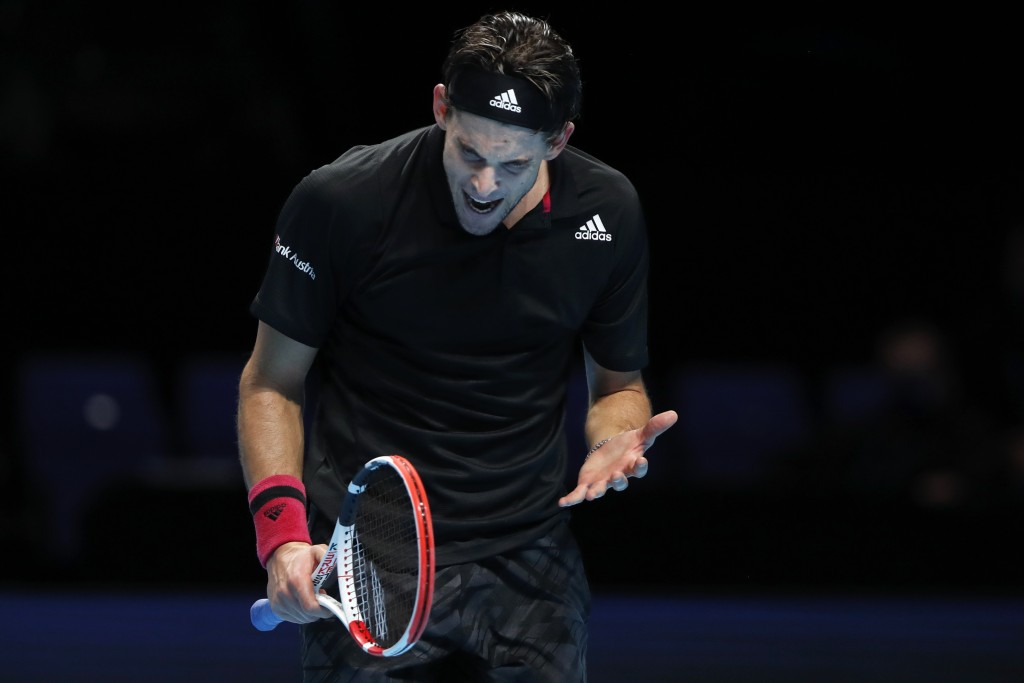 Dominic Thiem of Austria reacts after losing a point against Daniil Medvedev of Russia during their singles final tennis match at the ATP World Finals...