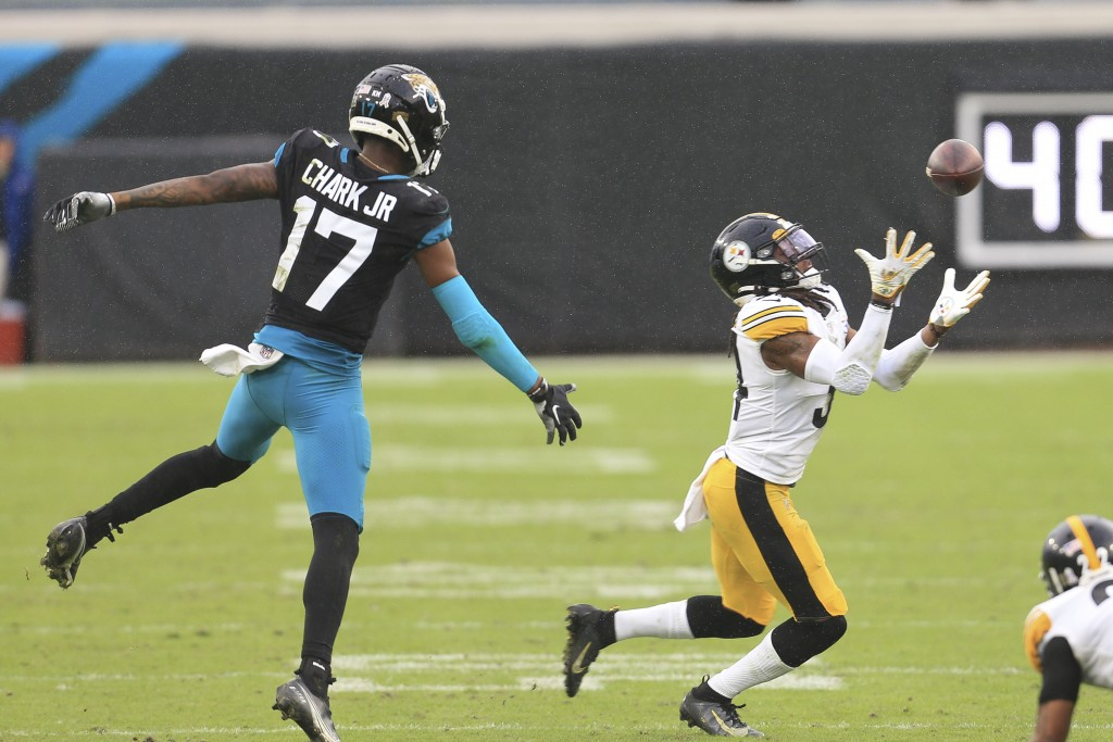 Pittsburgh Steelers safety Terrell Edmunds, right, intercepts a pass intended for Jacksonville Jaguars wide receiver DJ Chark Jr. (17) during the seco...