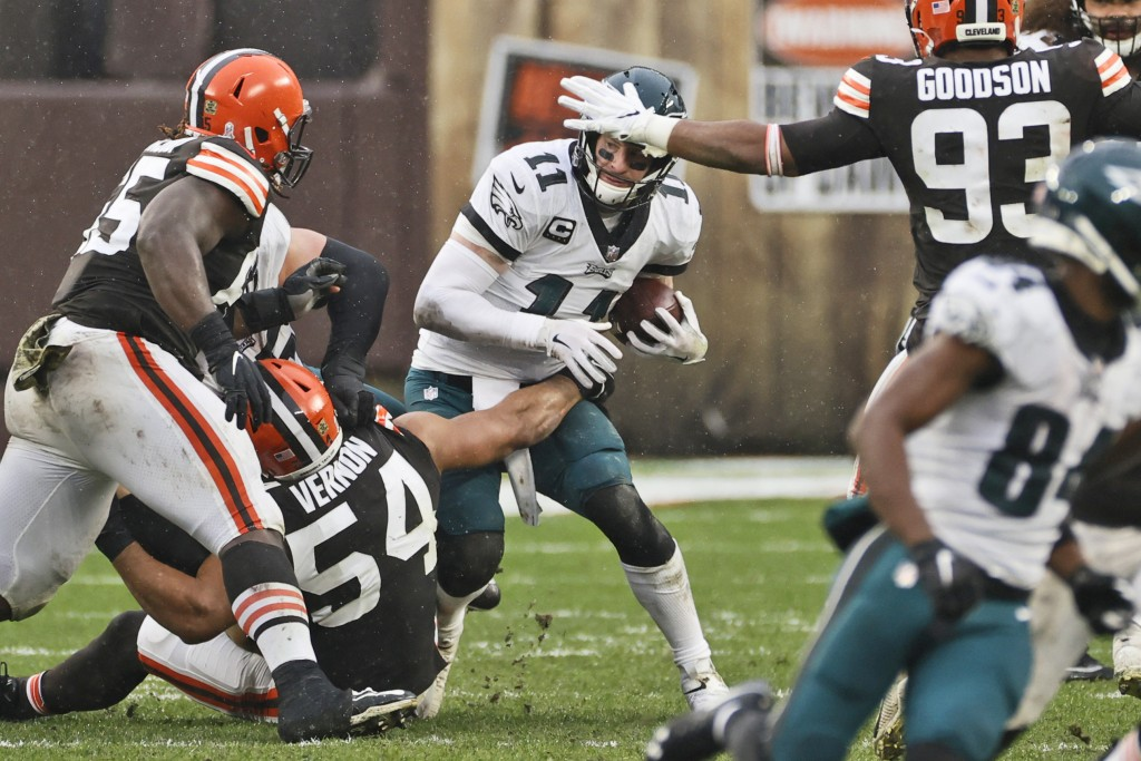 Philadelphia Eagles quarterback Carson Wentz (11) is sacked by Cleveland Browns defensive end Olivier Vernon (54) during the second half of an NFL foo...