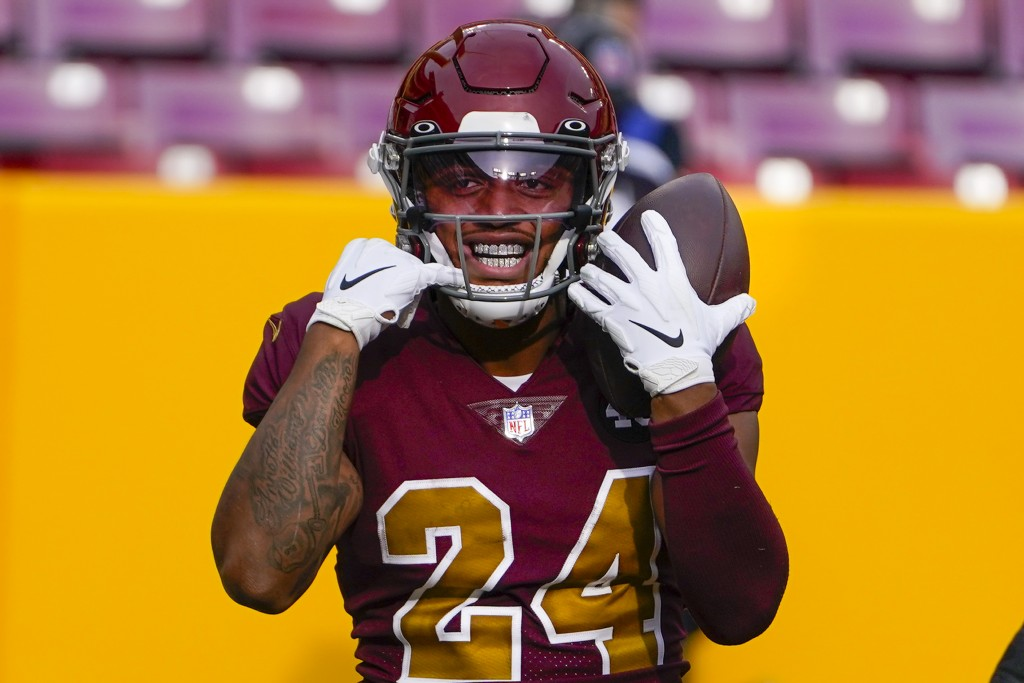 Washington Football Team running back Antonio Gibson (24) smiling as he celebrates his touchdown against the Cincinnati Bengals during the first half ...