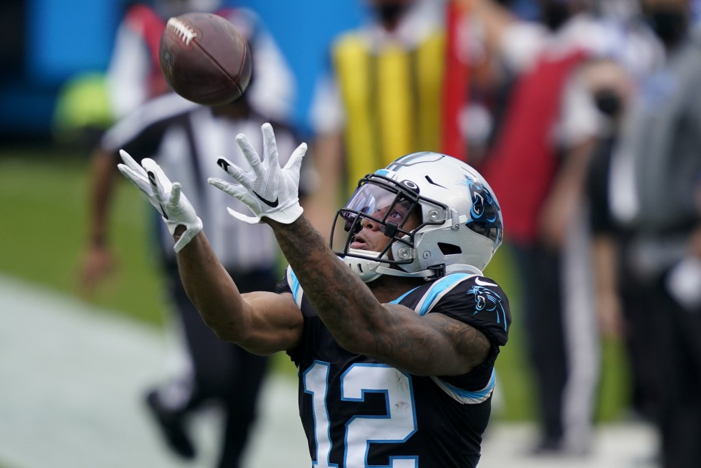 Carolina Panthers wide receiver D.J. Moore catches a pass during the first half of an NFL football game against the Detroit Lions Sunday, Nov. 22, 202...