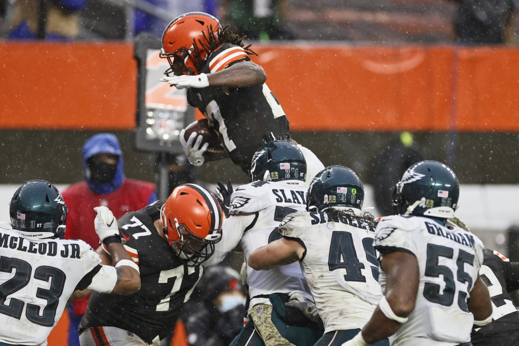 Cleveland Browns running back Kareem Hunt, top, rushes for a 5-yard touchdown during the second half of an NFL football game against the Philadelphia ...