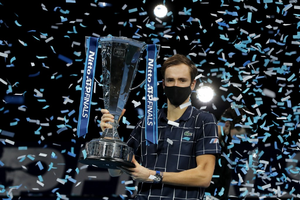 Daniil Medvedev of Russia holds up the winners trophy as confetti falls after defeating Dominic Thiem of Austria in the final of the ATP World Finals ...