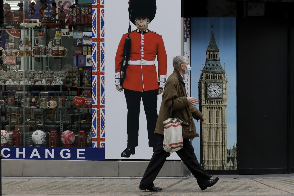 Person walks pasttemporarily closed souvenir store on Oxford Street, during England's second coronavirus lockdown, in London, Monday, Nov. 2...