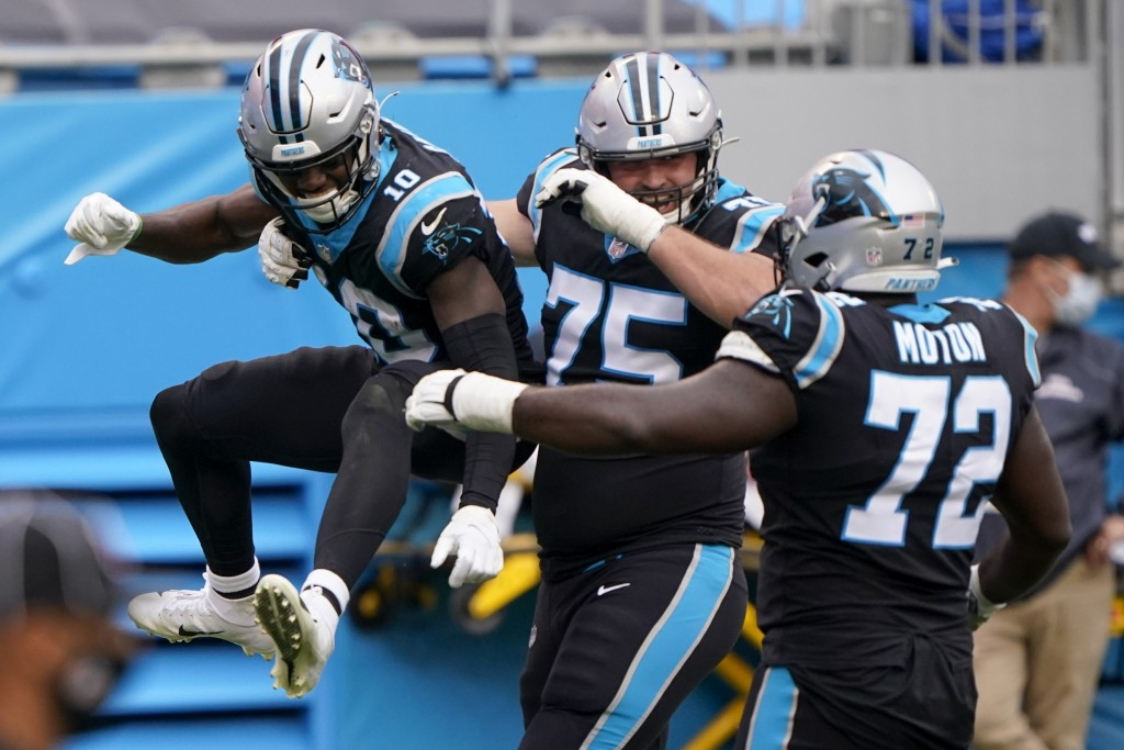 Carolina Panthers wide receiver Curtis Samuel, left, celebrates after scoring with Michael Schofield and Taylor Moton during the second half of an NFL...