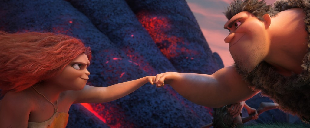 This image released by DreamWorks shows Eep Crood, voiced by Emma Stone, left, and Grug Crood, voiced by Nicolas Cage, in a scene from the animated fi...