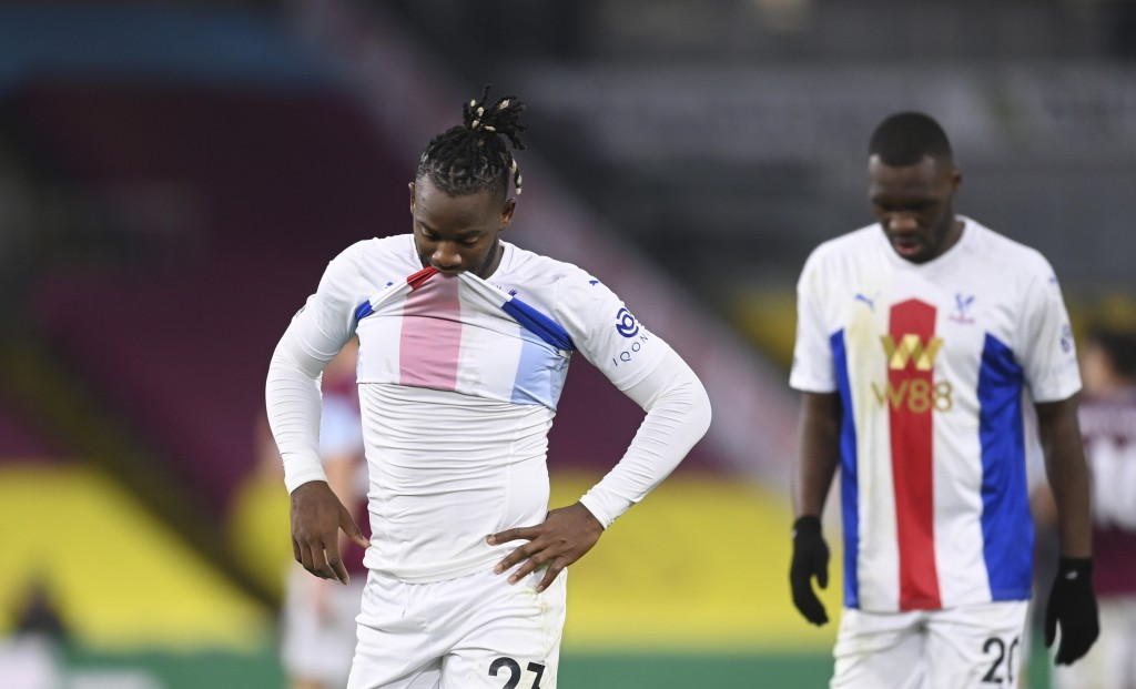 Crystal Palace's Michy Batshuayi, left, and Crystal Palace's Christian Benteke leave the field after the English Premier League soccer match between B...