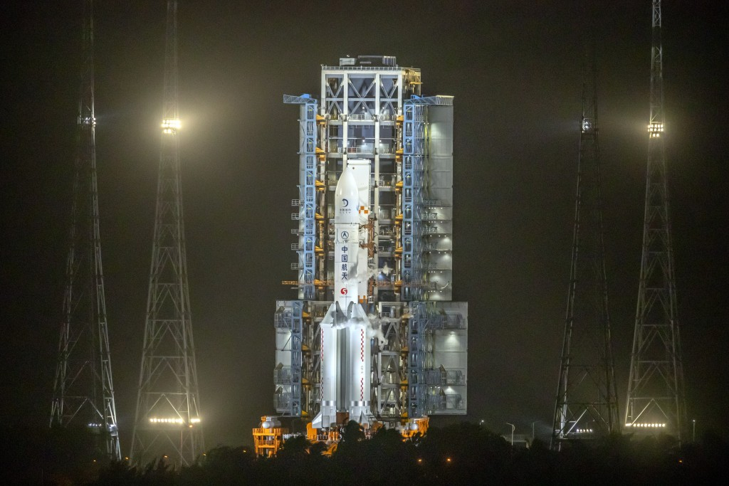 A Long March-5 rocket sits on the launch pad at the Wenchang Space Launch Center in Wenchang in southern China's Hainan Province, early Tuesday, Nov. ...