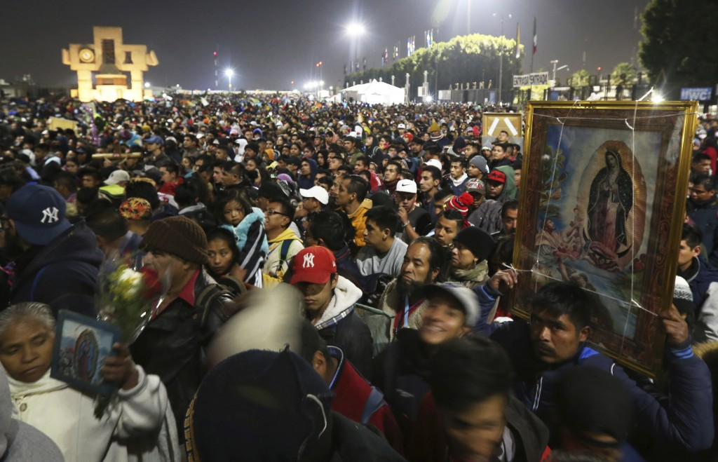 FILE - In this Dec. 12, 2019 file photo, pilgrims arrive at the plaza outside the Basilica of Our Lady of Guadalupe in Mexico City. Due to the COVID-1...