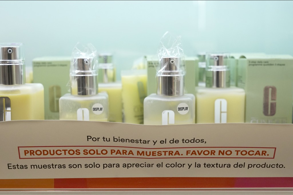 Cosmetics samples covered in plastic to prevent use sit on display at an Ulta beauty store Thursday, Nov. 19, 2020, on Chicago's Magnificent Mile. The...