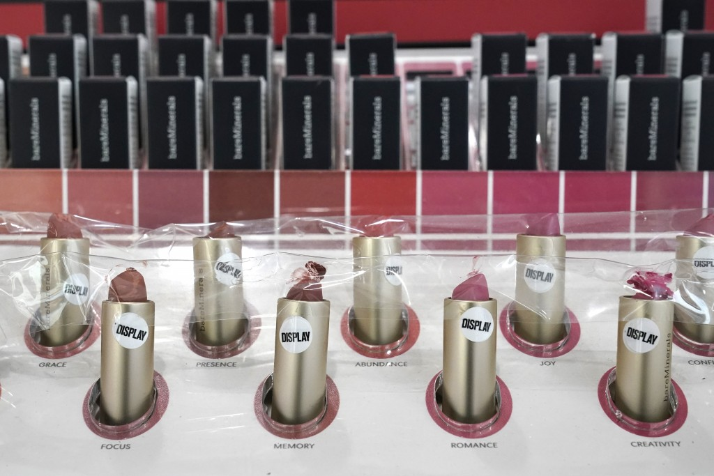 Lipstick samples covered in plastic to prevent use at an Ulta beauty store sit on display Thursday, Nov. 19, 2020, in a store on Chicago's Magnificent...