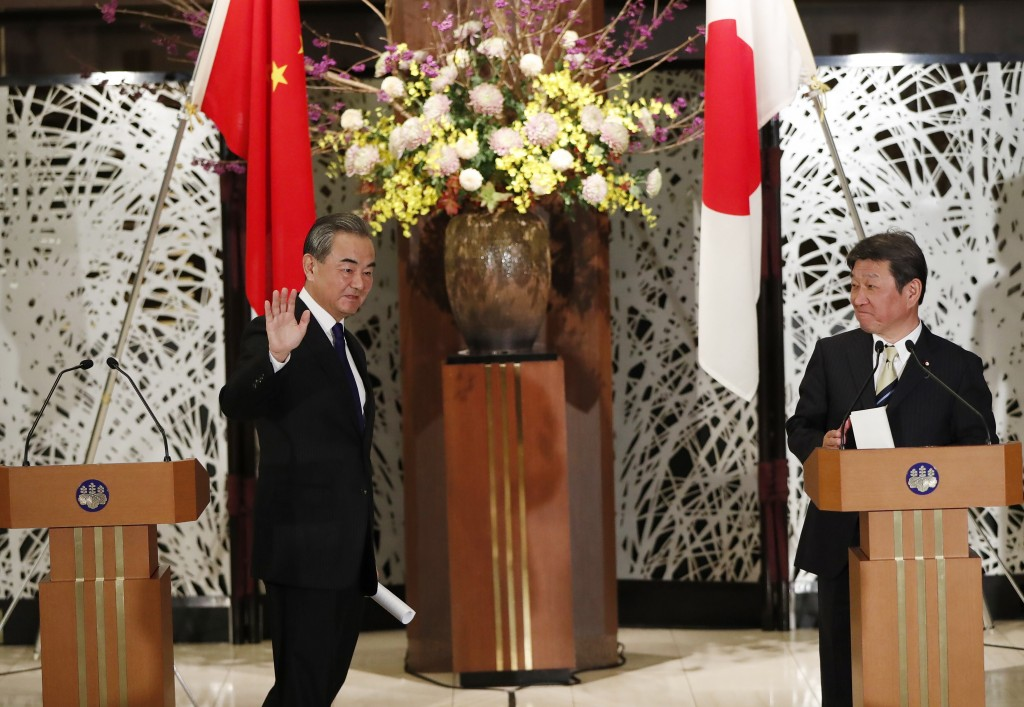 China' Foreign Minister Wang Yi, left, and his Japanese counterpart Toshimitsu Motegi conclude a press briefing in Tokyo on Tuesday, Nov. 24, 2020. Wa...