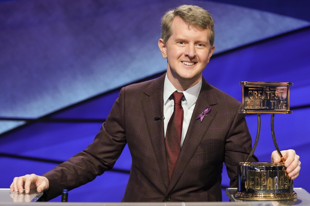 """This image released by ABS shows contestant Ken Jennings with a trophy on """"JEOPARDY! The Greatest of All Time."""" Jennings will be the first interim gue..."""