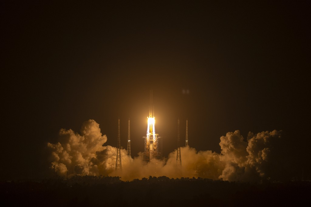 A Long March-5 rocket carrying the Chang'e 5 lunar mission lifts off at the Wenchang Space Launch Center in Wenchang in southern China's Hainan Provin...