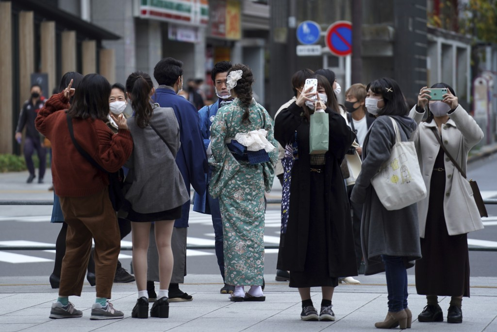 People wearing protective masks to help curb the spread of the coronavirus visit Asakusa district Tuesday, Nov. 24, 2020, in Tokyo. The Japanese capit...