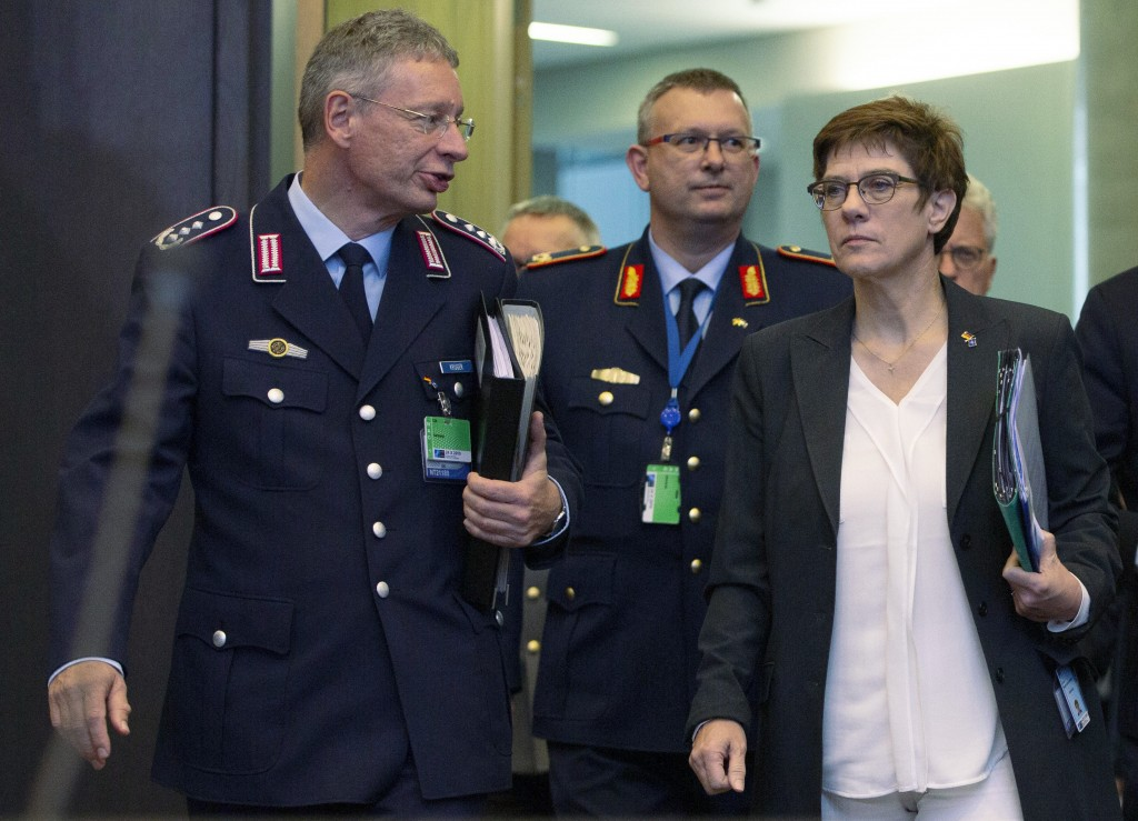 FILE - In this Thursday, Oct. 24, 2019 file photo German Defense Minister Annegret Kramp Karrenbauer, front right, arrives for a meeting of NATO defen...