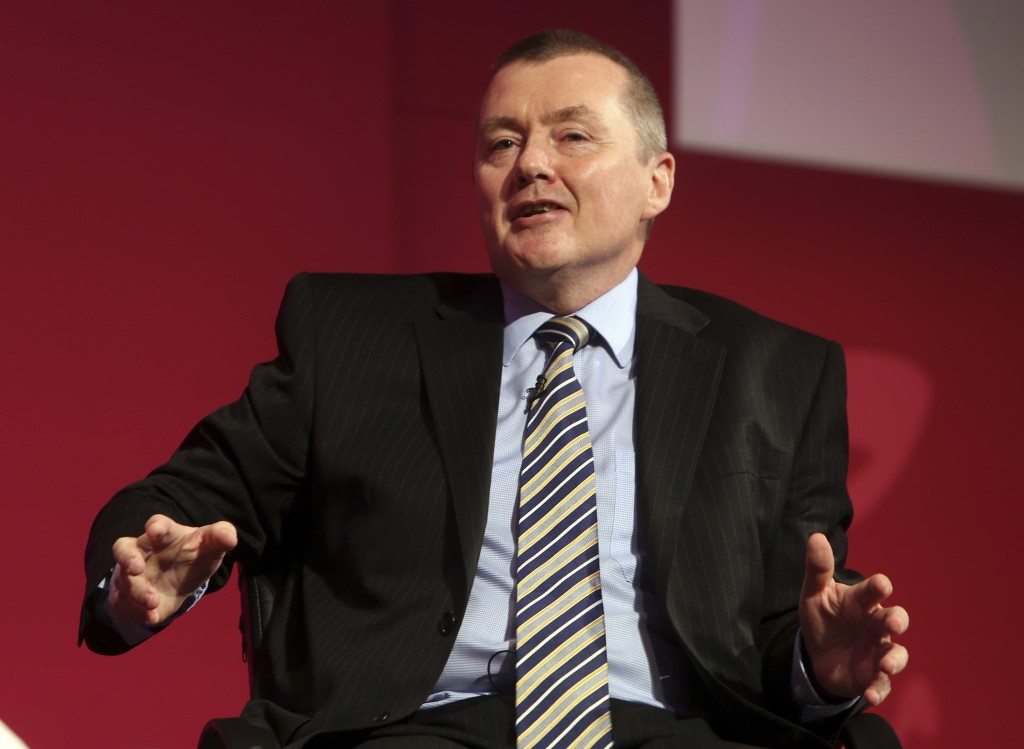 FILE - In this June 2, 2014 file photo, Willie Walsh, chief executive officer for International Airlines Group, speaks during a panel discussion of th...
