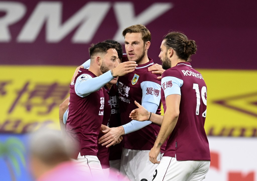 Burnley's Chris Wood, centre, celebrates with teammates after scoring his side's opening goal during the English Premier League soccer match between B...