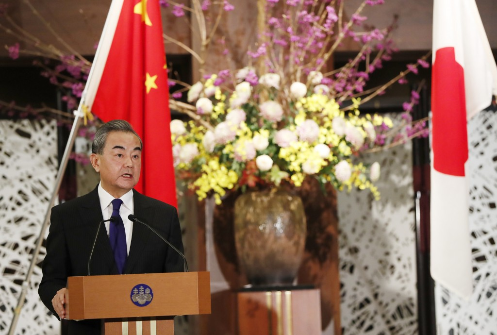 China' Foreign Minister Wang Yi, left, and his Japanese counterpart Toshimitsu Motegi (unseen) participate in a press briefing in Tokyo on Tuesday, No...