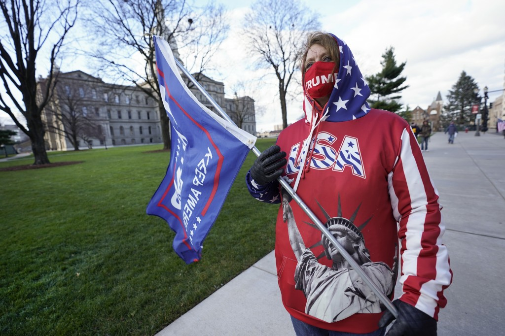 Lisa McClain, a President Trump supporter, walks near the Capitol building in Lansing, Mich., Monday, Nov. 23, 2020. Michigan's elections board is mee...