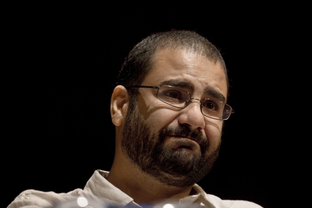 FILE - In this Sept. 22, 2014, file photo, Egypt's leading pro-democracy activist Alaa Abdel-Fattah takes a moment as he speaks about his late father ...