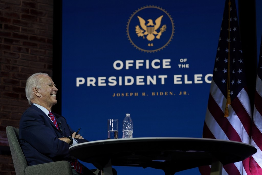 President-elect Joe Biden smiles as he meets virtually with the United States Conference of Mayors at The Queen theater Monday, Nov. 23, 2020, in Wilm...