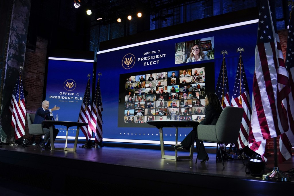 President-elect Joe Biden and Vice President-elect Kamala Harris attend a meeting at The Queen theater Monday, Nov. 23, 2020, in Wilmington, Del. (AP ...