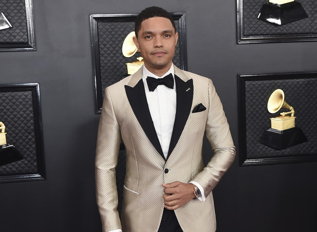 FILE - Trevor Noah arrives at the 62nd annual Grammy Awards in Los Angeles on Jan. 26, 2020. Noah has been tapped to host the 2021 Grammy Awards. The ...