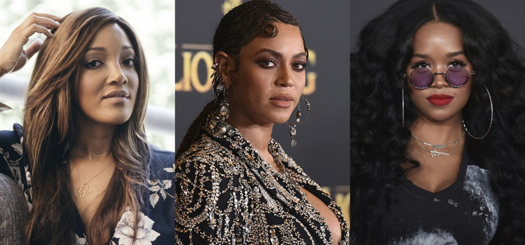 This combination photo shows from left, Mickey Guyton, Beyonce Knowles and H.E.R., whose songs about the Black experience all landed Grammy nomination...