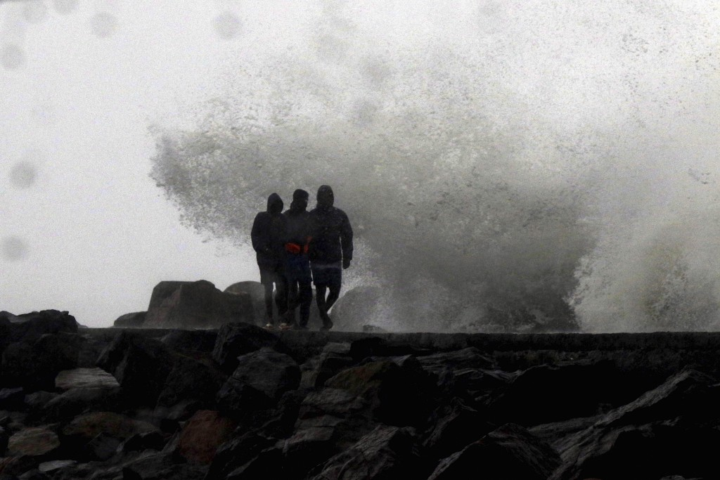 Waves hit the shore during a high tide at the Kasimedu Harbor on the Bay of Bengal coast in Chennai, India, Wednesday, Nov.25, 2020. India's southern ...