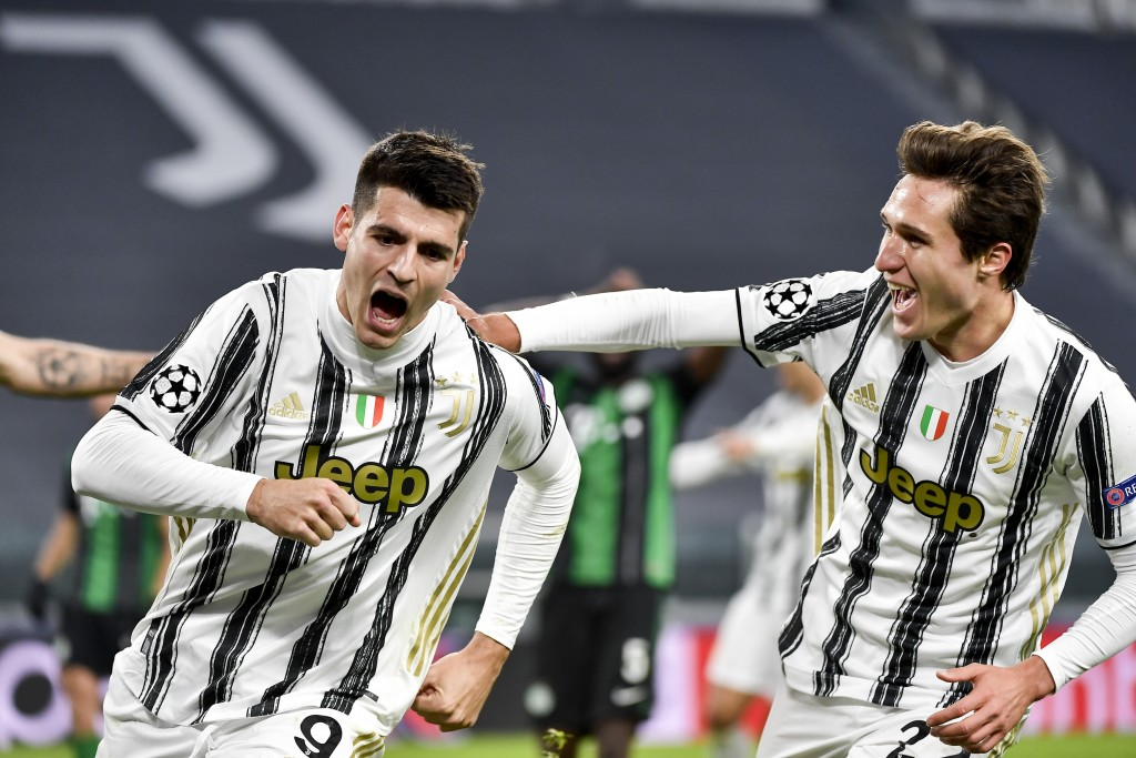 Juventus' Alvaro Morata celebrates a goal with teammate Federico Chiesa during the Champions league, group G soccer match between Juventus and Ferencv...