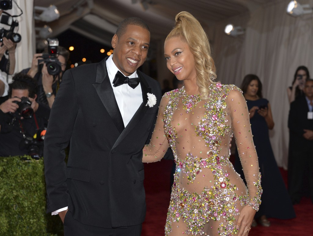 FILE - In this May 4, 2015, file photo, Jay Z, left, and Beyonce arrive at The Metropolitan Museum of Art's Costume Institute benefit gala celebrating...
