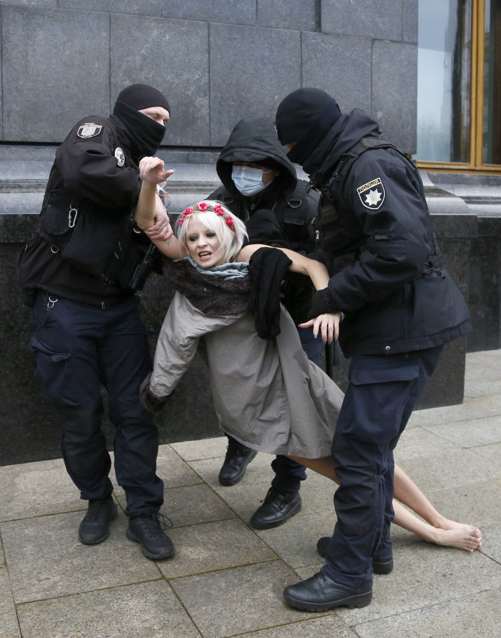 "Police detain an activist from Ukrainian female rights organization ""Femen"" on the International Day for the Elimination of Violence against Women as ..."