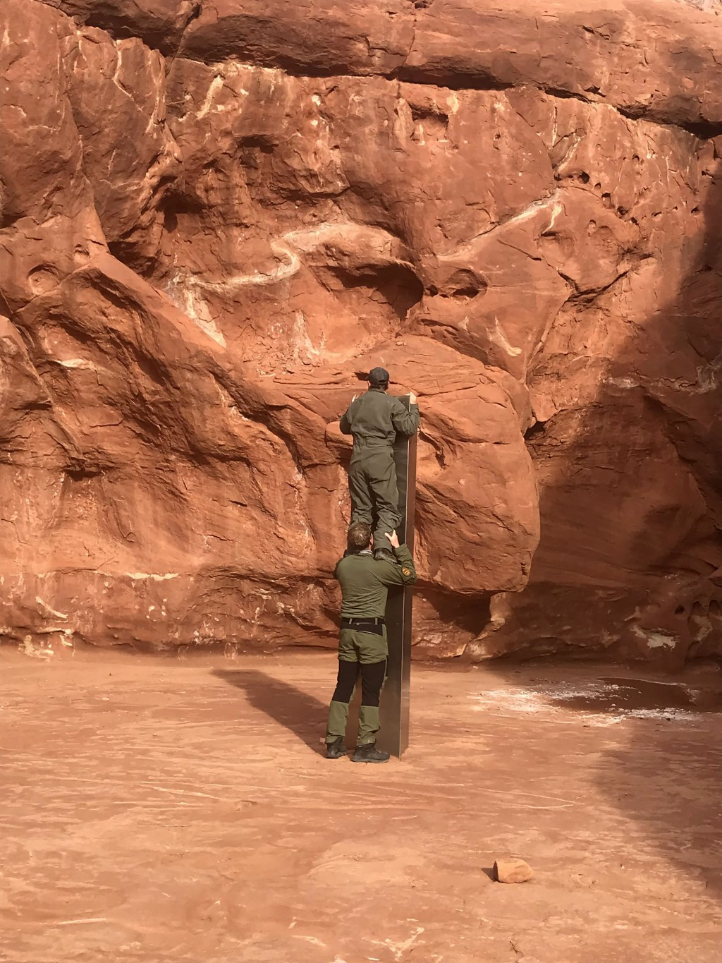 This Nov. 18, 2020 photo provided by the Utah Department of Public Safety shows Utah state workers checking out a metal monolith that was found instal...