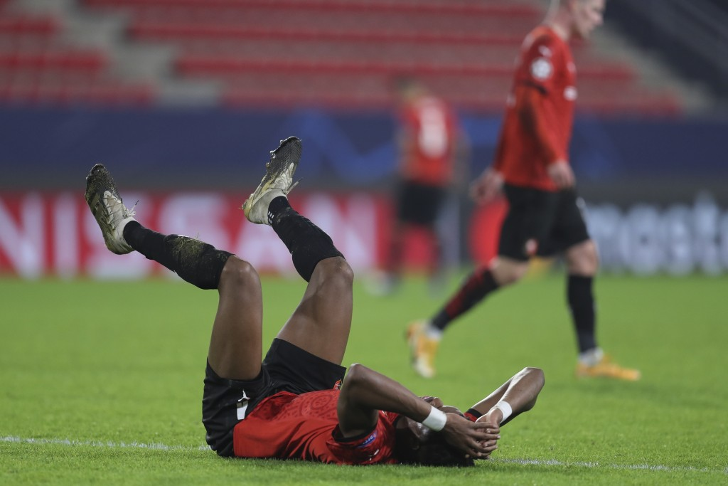 Rennes' Gerzino Nyamsi reacts after the Champions League, group E soccer match between Rennes and Chelsea at the Roazhon Park stadium in Rennes, Franc...