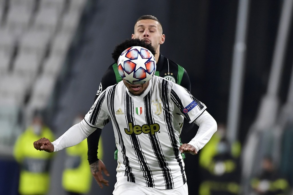 Juventus' Weston McKennie, foreground is challenged by Ferencvaros' Marcel Heister, during the Champions league, group G soccer match between Juventus...