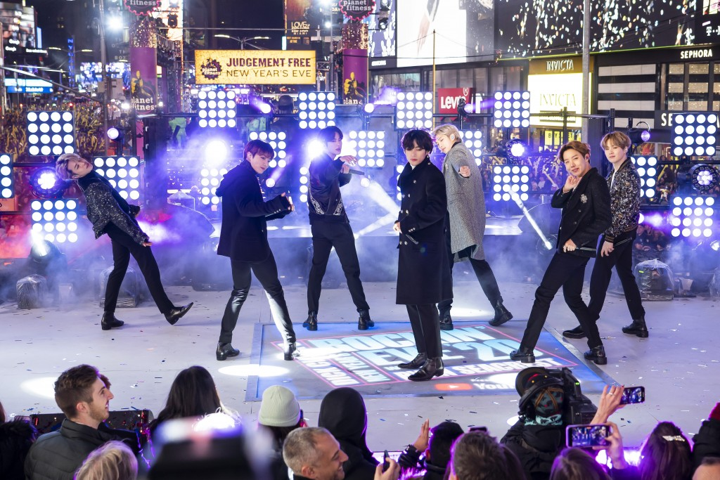 FILE - Members of BTS perform at the Times Square New Year's Eve celebration in New York on Dec. 31, 2019. The K-pop band is nominated for a Grammy Aw...
