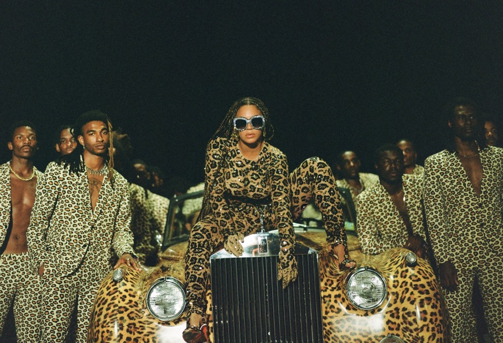 """This image released by Disney Plus shows Beyonce Knowles, center, in a scene from her visual album """"Black is King.""""  The pop star scored multiple Gram..."""