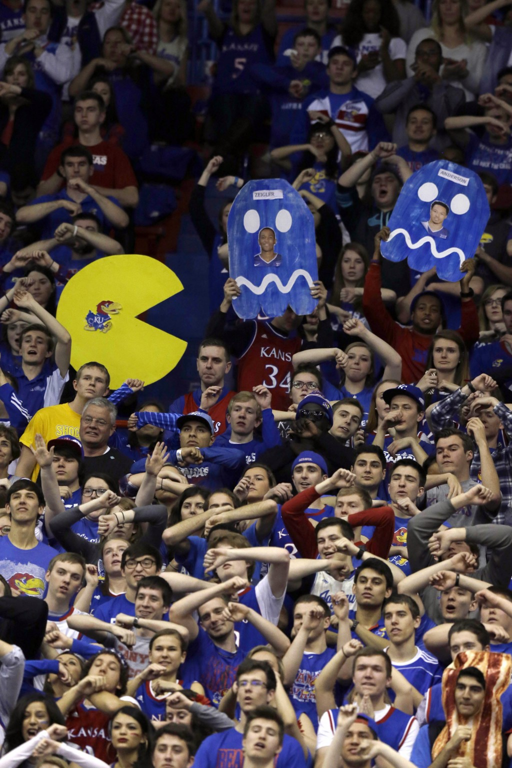 FILE- In this Feb. 21, 2015, file photo, Kansas fans cheer during the first half of an NCAA college basketball game against TCU at Allen Fieldhouse in...