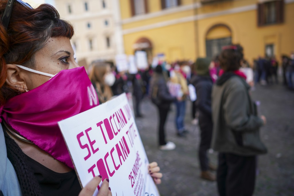 Women take part in a demonstration on the International Day for the Elimination of Violence against Women, in Rome, Wednesday, Nov. 25, 2020. (AP Phot...