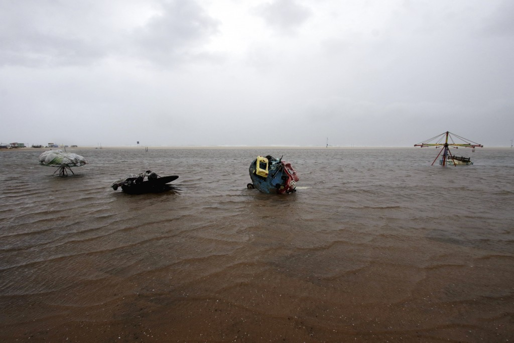 Children's joy rides are partially submerged in water at the Marina Beach on the Bay of Bengal coast in Chennai, India, Wednesday, Nov.25, 2020. India...