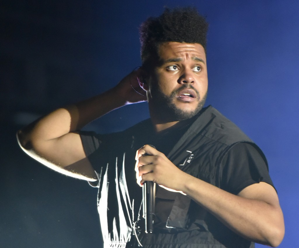 FILE - The Weeknd performs on day three at Lollapalooza in Chicago on Aug 4, 2018. The Weeknd, who was nominated for eight American Music Awards, was ...