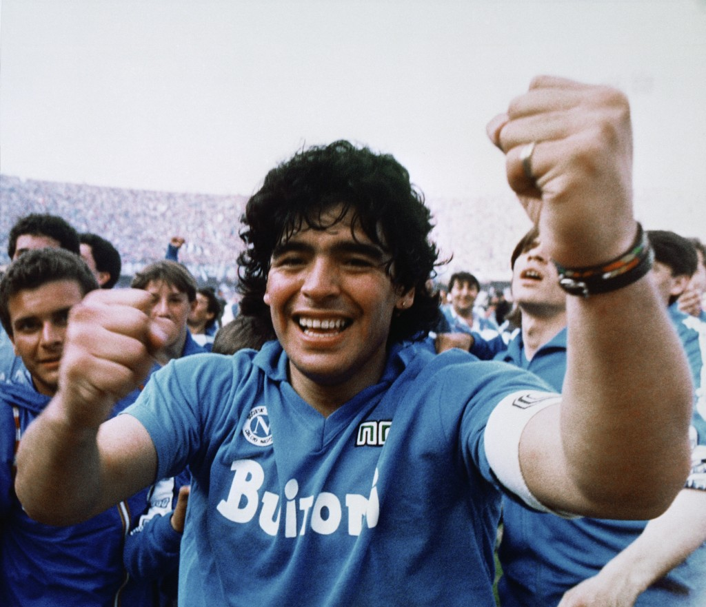 Argentine soccer superstar Diego Armando Maradona cheers after the Napoli team clinched its first Italian major league title in Naples, Italy, on May ...