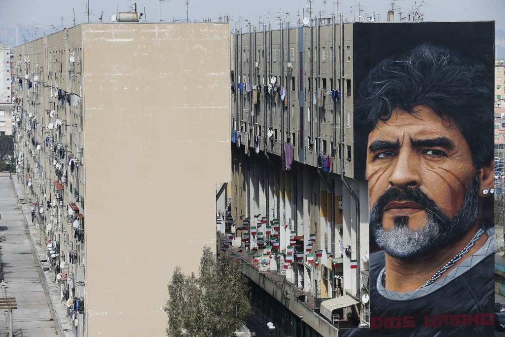 A mural depicting Diego Maradona, by street artist Jorit, is painted on a building in Naples, Italy, March 24, 2017.  Diego Maradona has died. The Arg...